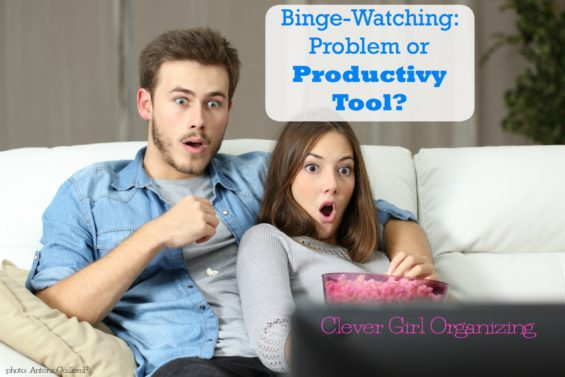 couple watching tv  - Binge watching is a productivity tool